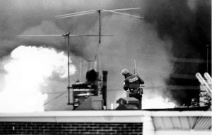Philadelphia police on May 13, 1985 ensure MOVE members burn to death