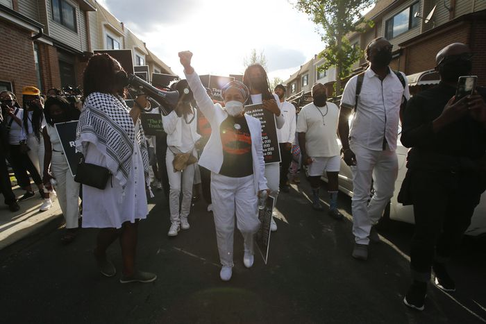 Pam Africa leads march