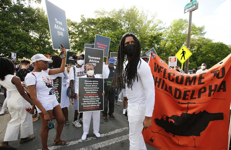 Mike Africa Jr. leads marchers on March 13, 2021