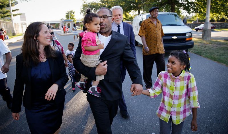 Anthony Wright holding hands of two granddaughters.